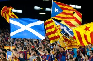 "Catalunya's separatist supporters wave ""Esteladas"" supporting Scotland's independence during FC Barcelona's Champions League soccer match against Apoel Nicosia in Barcelona"